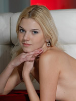 Super cute blonde naked on the couch